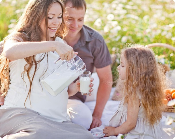 family enjoying non dairy milk outdoors
